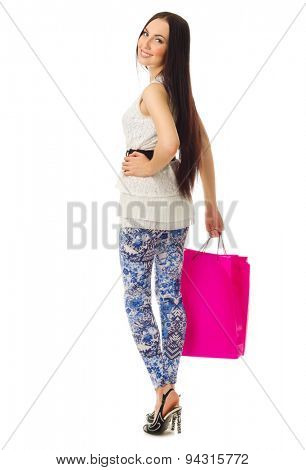 Young girl in blue pants with bags isolated
