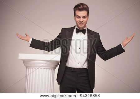 Attractive elegant business man welcoming you with his arms open.