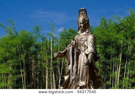 Guan Yin Statue In Bamboo Garden