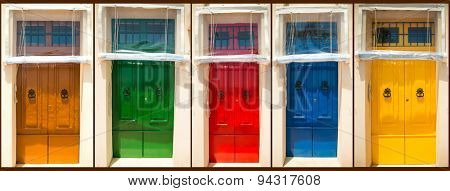 photo collage of five colourful front doors to houses