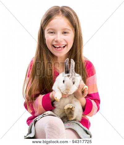 cute smiling girl in a crimson sweater  with baby rabbit isolated over white close-up