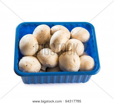 mushrooms in a plastic pack isolated on white background. top view