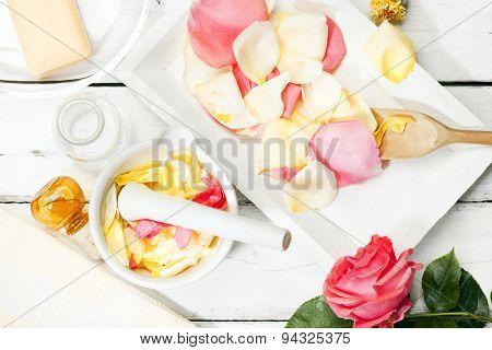 Preparing rose petals for aromatic essences in a mortar