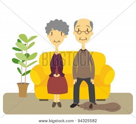 Senior Couple Sitting In A Couch