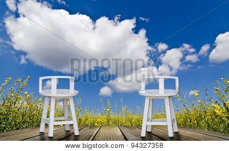 White Chairs And Blue Sky