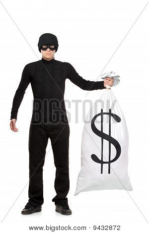 Full Length Portrait Of A Thief Holding A Bag With Us Sign