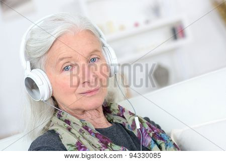 Old lady with headphones on