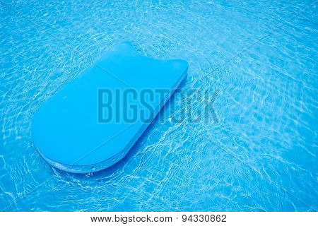 pool kick board in swimming pool, summer
