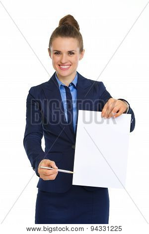 Businesswoman Holding Up Blank Paper, Pointing With Pen
