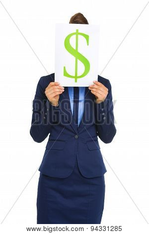 Businesswoman Holding Dollar Sign In Front Of Face