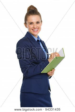 Happy Businesswoman Smiling At Camera, Holding Notebook And Pen