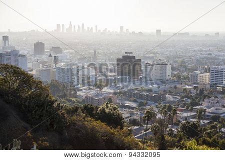 HOLLYWOOD, CALIFORNIA, USA - January 1, 2015:  Smoggy haze filled morning sky above Hollywood and downtown Los Angeles in Southern California.