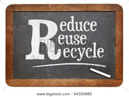 Reduce, reuse, recycle blackboard sign - white chalk text on a vintage slate blackboard