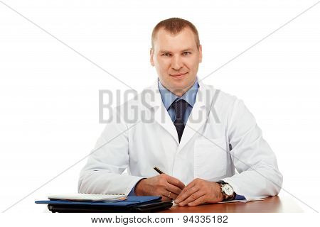 Portrait Of A Young Male Doctor In A White Coat
