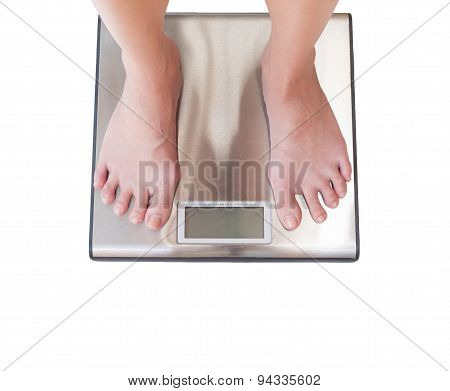 Close-up Of Woman Feet Weighing Scale Isolated On White Background.