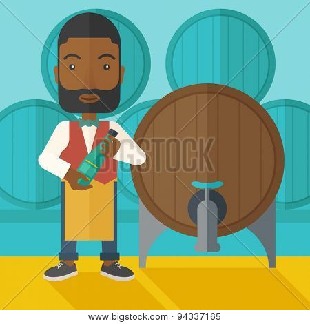 An african wine maker standing wearing his apron holding a bottle of wine inspecting from barrel inside the wine storage room. A contemporary style with pastel palette dark blue tinted background