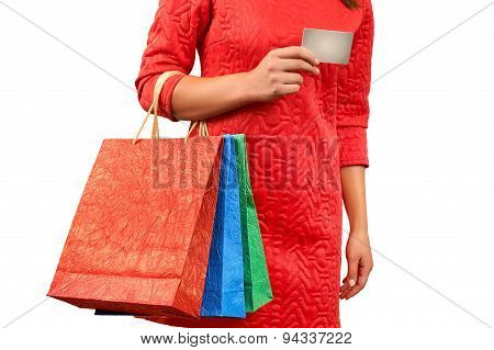 Woman With A Gift Bag And A Credit Card On A White Background