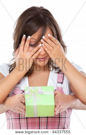 Young Woman Opening A Present