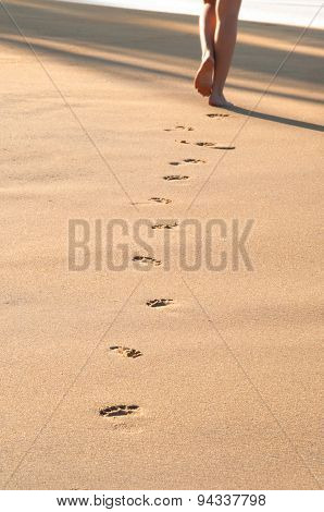 Footprints on the beach left behind