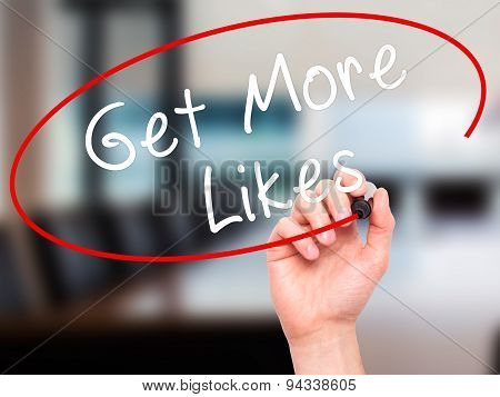 Man Hand writing Get More Likes black marker on visual screen.