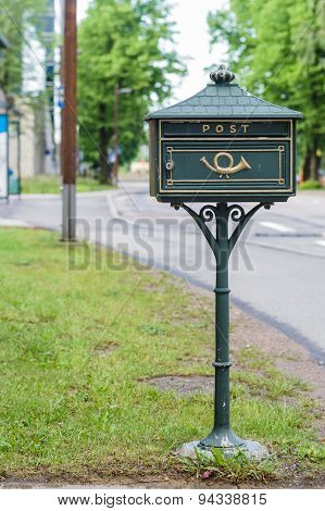 Green Vintage Mail Box With Urban Background