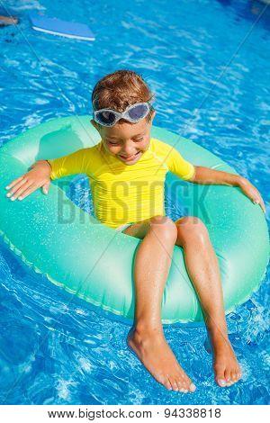Little boy relax in pool