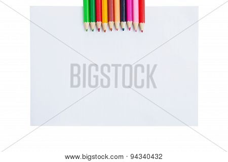 Colour pencils and paper blank isolated on white background