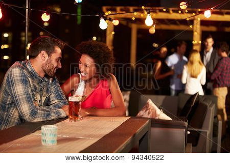 Couple at a rooftop party