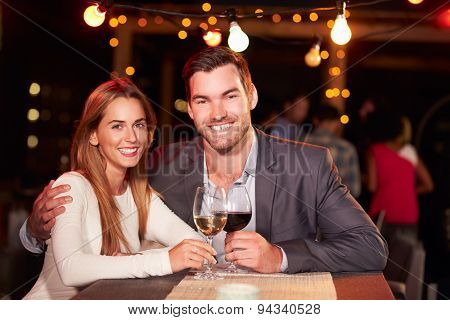 Couple at rooftop party
