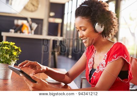 Woman using a laptop at a coffee shop