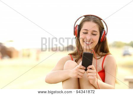 Candid Teen Girl Listening To The Music From A Smart Phone