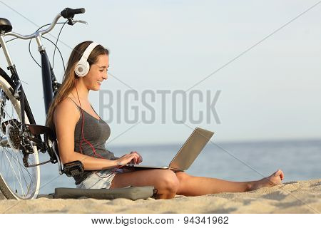 Teen Girl Studying With A Laptop On The Beach