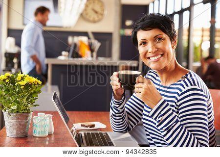 Woman drinking coffee, portrait