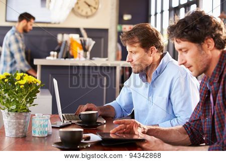 Two men meeting at a coffee shop