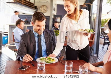 Business man being served food in a restaurant
