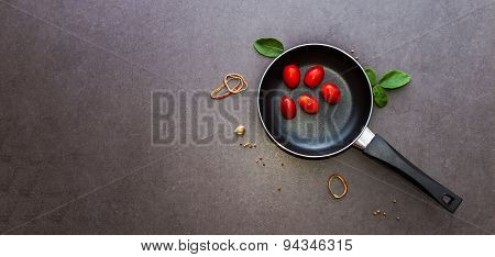 Fresh Tomatoes On The Pan Background.