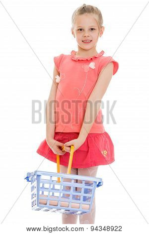 child with a shopping basket , close-up