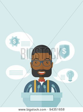 A black speaker stands behind a podium with microphones makes a business report  and marketing strategy inside the conference room. Presentation, reporting concept. A Contemporary style with pastel