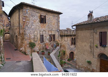 Exterior of the medieval houses in early spring in San Gimignano, Italy.