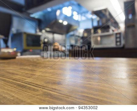 Top Of Wooden Counter With Blurred Kitchen Restaurant Interior Background