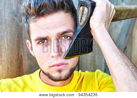 man shaves with an axe