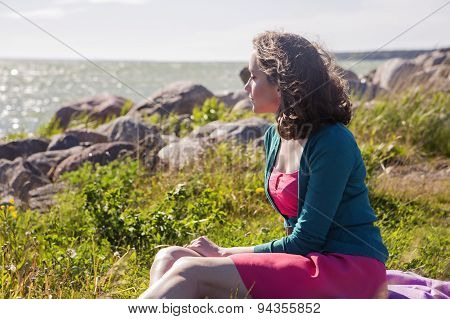 Focused Female On Romantic Evening At Seaside