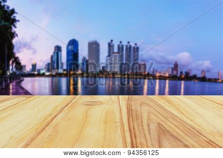 Wooden Board With Defocus City Background