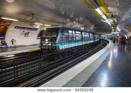 Parisian Subway Station With Moving Train