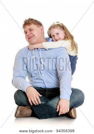 Younger sister hugs her beloved older brother
