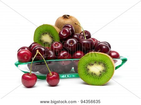 Ripe Kiwi And Cherry Closeup On A White Background