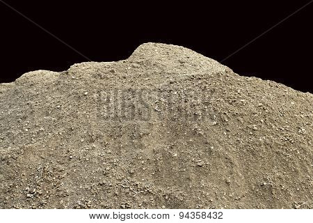 Pile of natural unsifted dirt with small pebbles and stones embedded - isolated on a black backgroun
