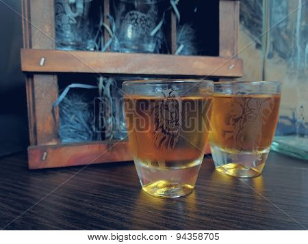 Cognac in etched glass on the table