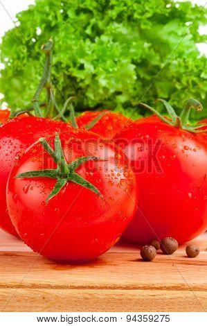 Fresh Wet Tomatoes, Allspice And Lettuce On Board Wooden Isolated On White Background
