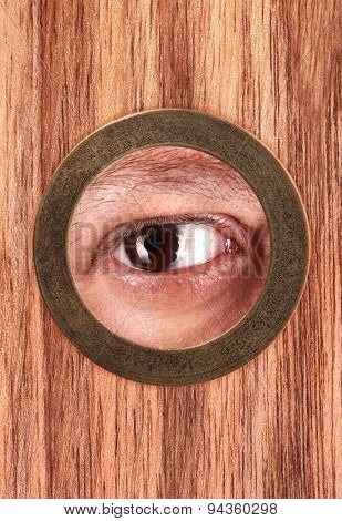 Eye is looking through peephole
